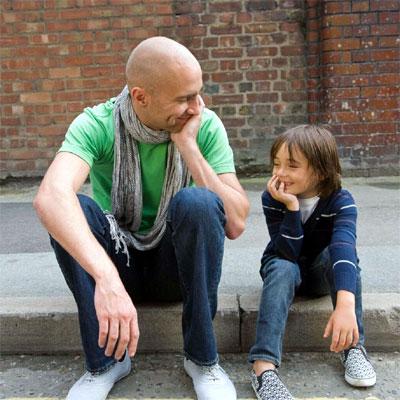 Man sitting by son.